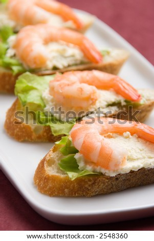 Closeup view of shrimp toasts with salad and garlic cheese (shallow DOF) - stock photo