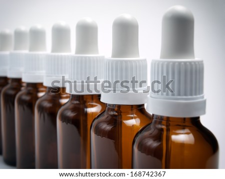 Closeup view of sorted bottles with droppers.
