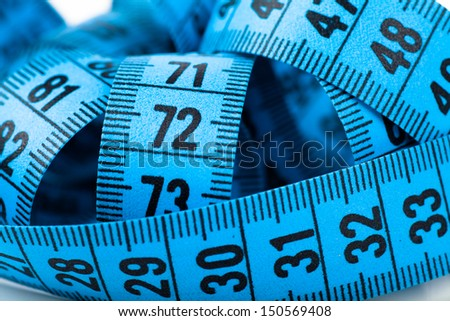 Closeup view of tangled blue measuring tape - stock photo