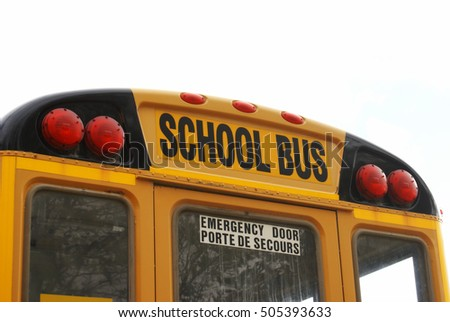 Closeup view of the back of a school bus.