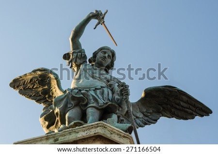 Closeup view of the beautiful ancient bronze statue of Michael the Archangel, standing on top of the Castle of the Holy Angel (Castel Sant'Angelo). Rome, Italy - stock photo