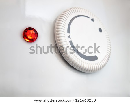 Closeup view of the water heater thermostat. - stock photo