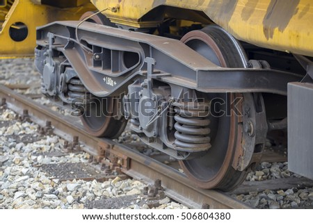 Closeup view of the wheels of a railway wagon. Selective focus.