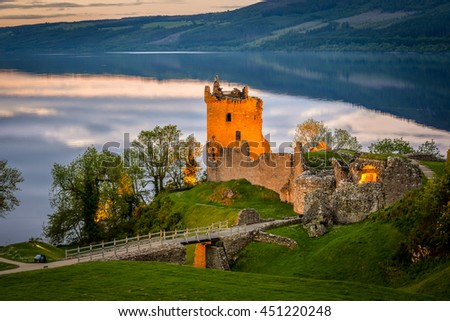 Closeup view of Urquhart Castle. The castle sits beside Loch Ness, near Inverness and Drumnadrochit, in the Highlands of Scotland. Only the tower of the castle is in focus; the rest is blur. - stock photo