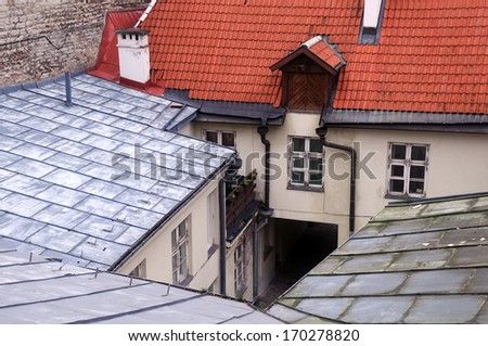 Closeup view overlooking the courtyard and roofs of the Old town in Tallin in Estonia - stock photo