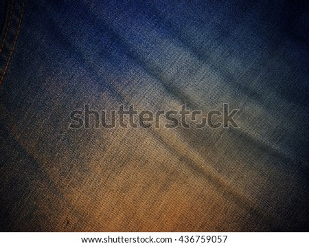 Closeup view to abstract background light blue natural clean denim and indigo texture denim fashion blue jean with vintage style