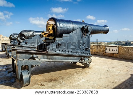 Closeup view to gun number six of Valetta saluting battery under bright sun, Matla