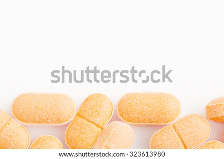 Closeup Vitamin C Tablets on White Background. - stock photo