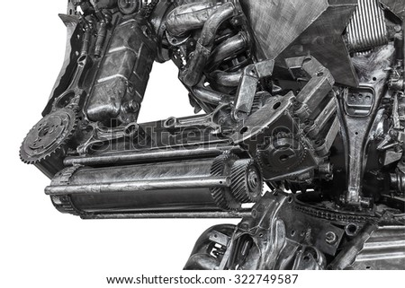 Closeup War machine sculpture made from scrap metal isolated on white background