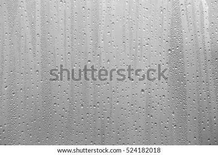 Closeup water condensation on window glass background