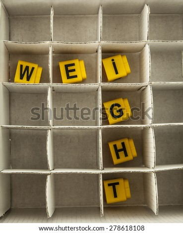 closeup weight wording isolated on white box cell background Yellow letter inside space Idea of warehouse or office  - stock photo