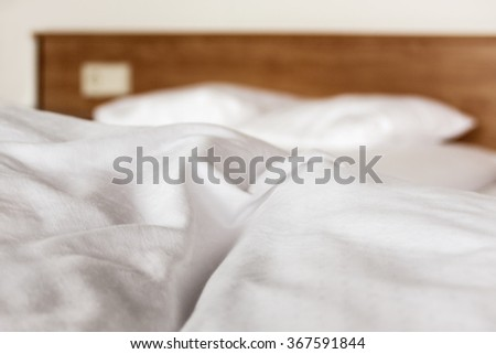 Closeup white bedding sheets in a hotel room, concept travel and vacation - stock photo