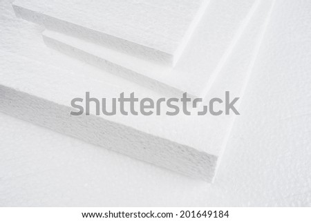 closeup white foam on cardboard - stock photo