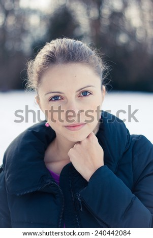 Closeup winter portrait of a beautiful young woman - stock photo