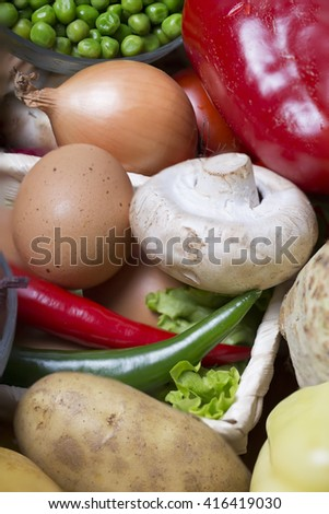 closeup with a lots of vegetable and  eggs on a wooden table