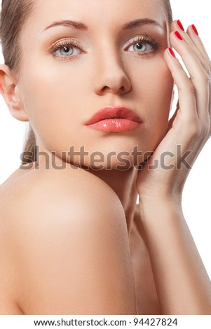 closeup woman face and hand with red nail - stock photo