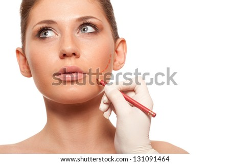 closeup woman face with surgery mark on her cheek - stock photo