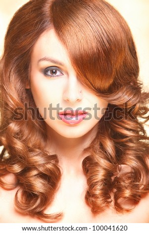 closeup woman portrait with gold curly hair - stock photo