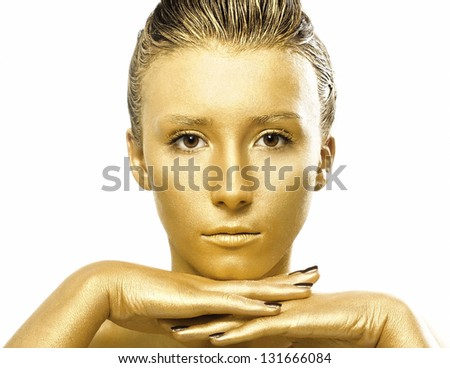 Closeup woman portrait with gold paint body art - stock photo