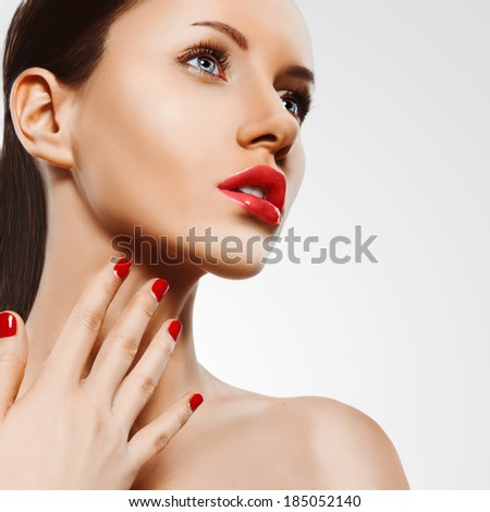 closeup woman portrait with red nails and lips over white, square format