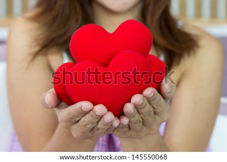 Closeup women happiness with many heart shape in hands