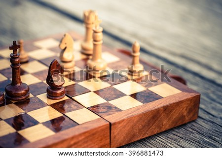 Closeup wood knight chess on chess game board