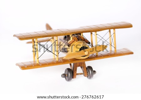 Closeup wooden airplane model flying isolated on a white background