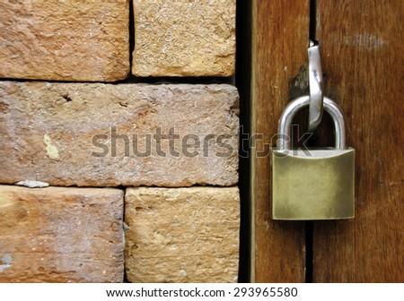 Closeup wooden door with lock - stock photo