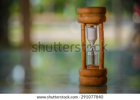 Closeup wooden hourglass ,blur background. - stock photo