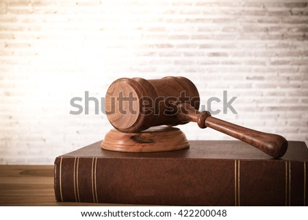 Closeup wooden judges gavel on table with law books. retro style. Concept of Legal. - stock photo