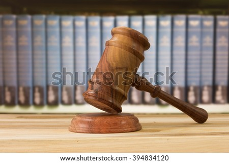 Closeup wooden judges gavel on wooden table with legal books. concept of lawyers ruling. - stock photo