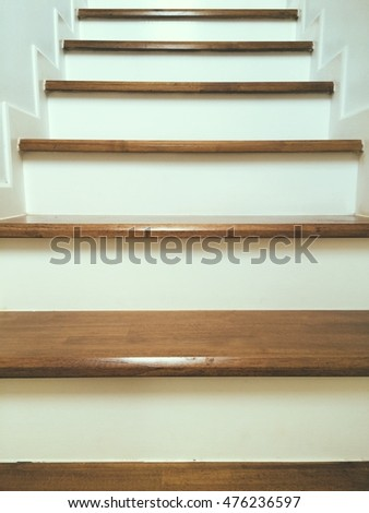Closeup wooden staircase made from laminate wood in white modern house