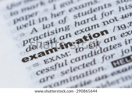 closeup word examination in dictionary, soft focus, - stock photo