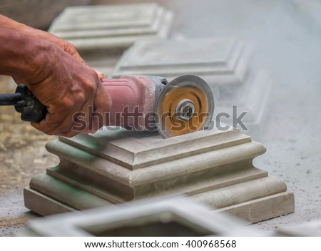 Closeup worker uses  cutter to cut  in real action - stock photo