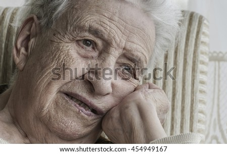closeup wrinkled face of a senior woman