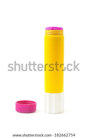closeup yellow glue stick with purple cap isolated on white background - stock photo