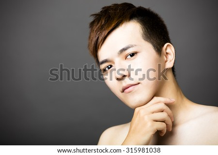 closeup young  asian handsome man face  - stock photo
