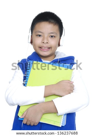 Closeup young child holding a book listening music - stock photo