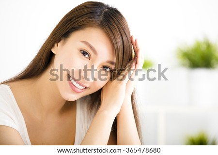 closeup young smiling woman  in living room - stock photo