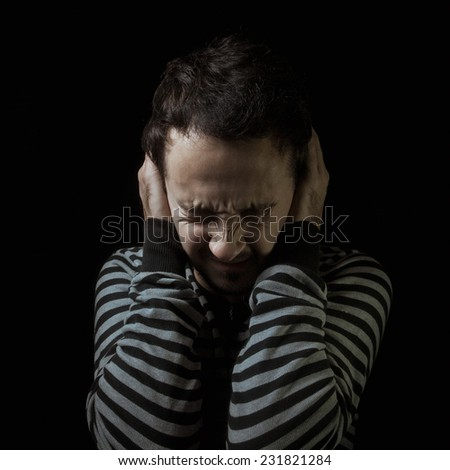 Closing ears scared man - stock photo