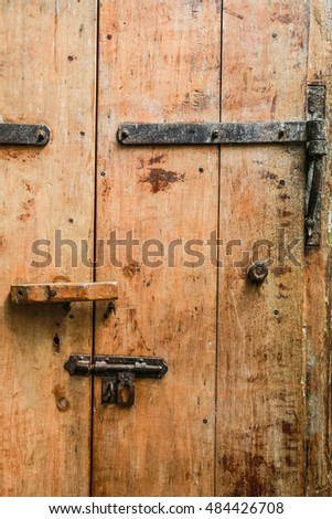 closup a brown old wooden door
