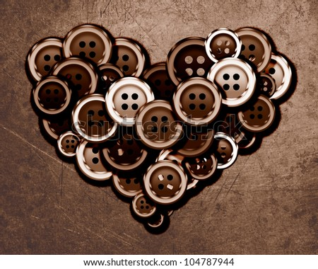 Cloth buttons, Love Heart formed from cloth buttons. - stock photo