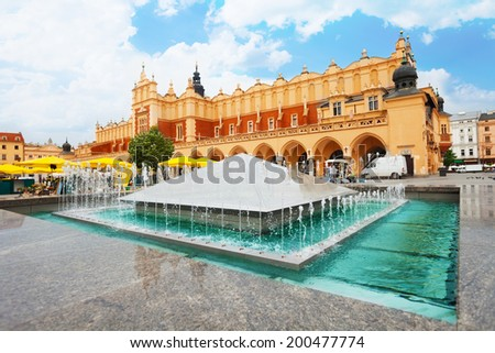 Cloth Hall on Rynek Glowny and fountain in Krakow - stock photo