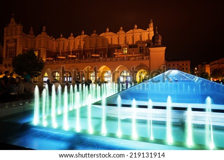 Cloth Hall on Rynek Glowny (main square) and fountain in Krakow, Poland - stock photo
