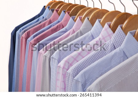 Cloth Hangers with Shirts in several colors and textures - stock photo