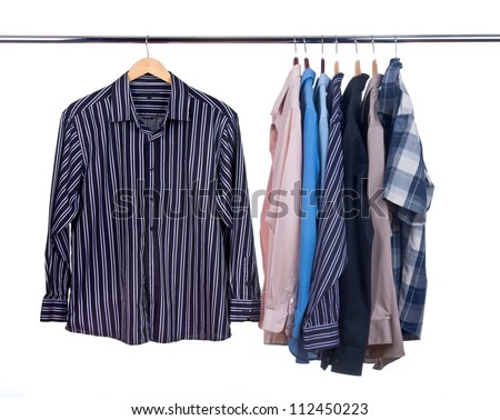 Cloth Hangers with Shirts on a hanger isolated