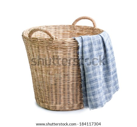 cloth in wicker basket on white blackground - stock photo