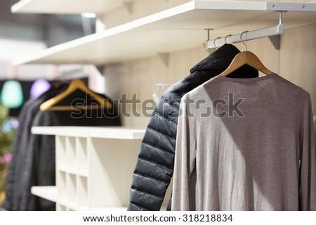 Cloth on hangers  - stock photo