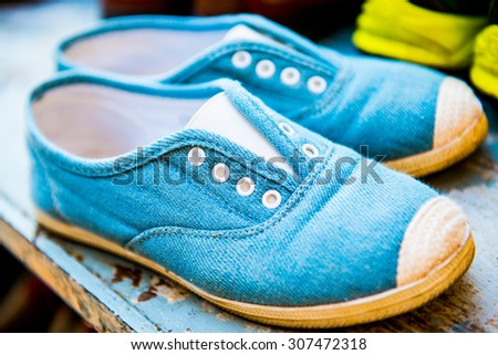 Cloth shoes on shoe rack, Thailand. - stock photo