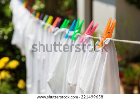 Cloth with colorful pins - stock photo